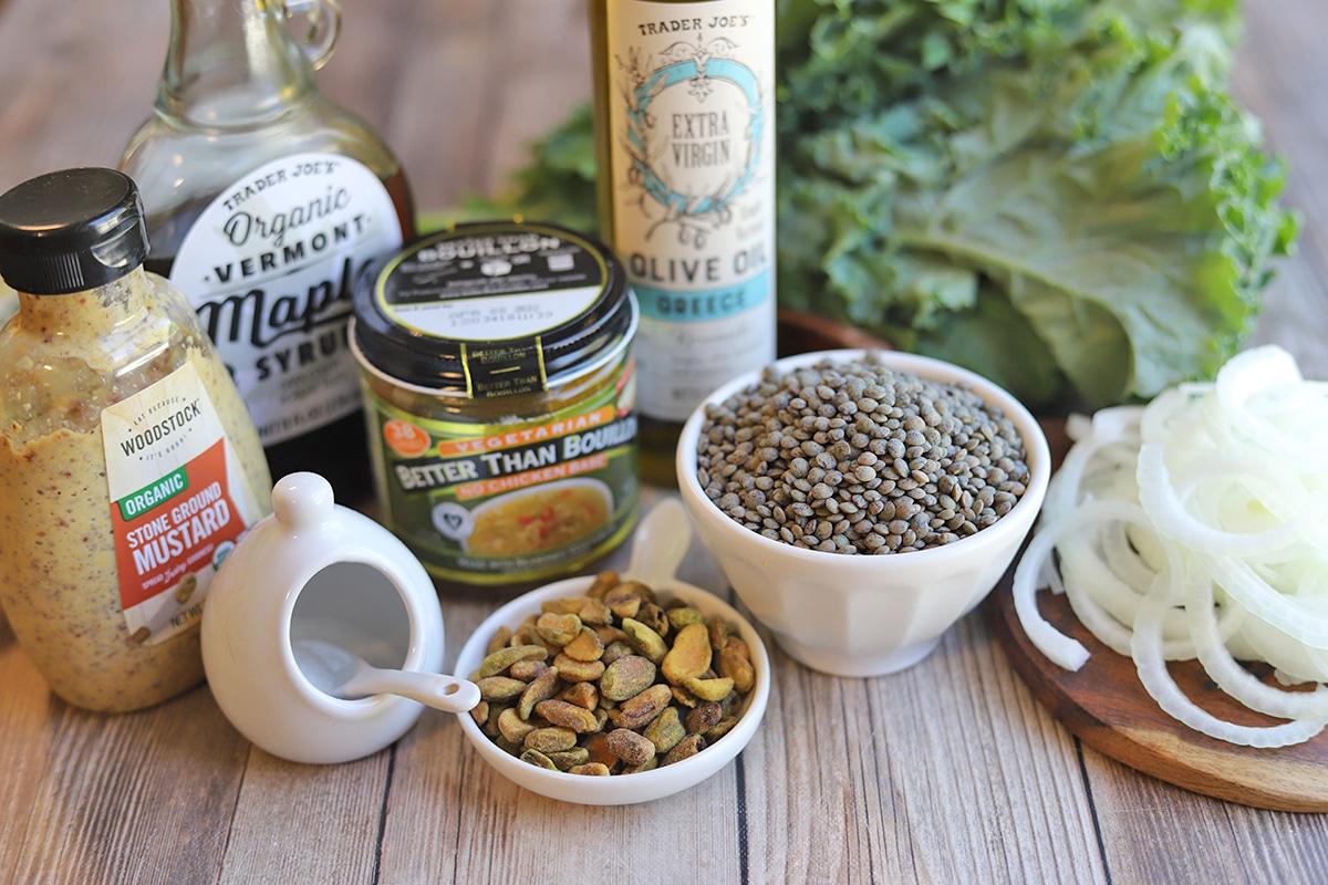 Ingredients for lentil recipe: dried lentils, olive oil, maple syrup, salt, kale, onions, pistachios, and bouillon.
