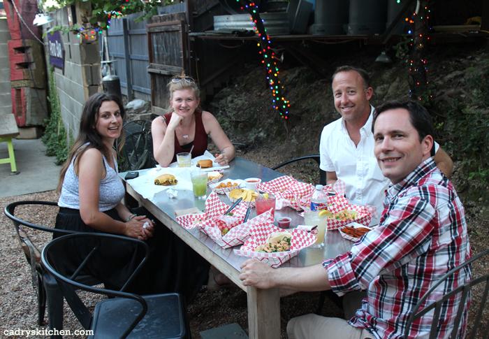 Jess, Sarah, Chris, and David at a table full of tacos.