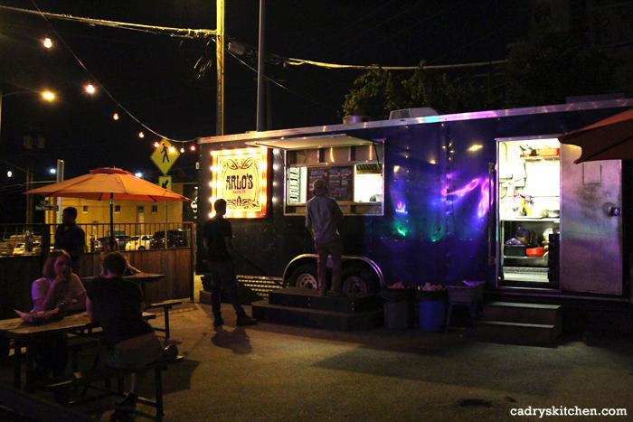 Exterior Arlo's food truck at night.