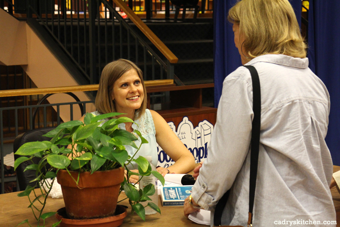 Kristy Turner signing copies of her cookbook at Book People.