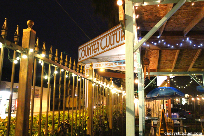 Exterior Counter Culture patio at night.