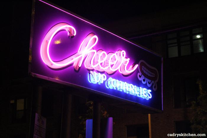 Cheer Up Charlies neon sign, lit up at night.