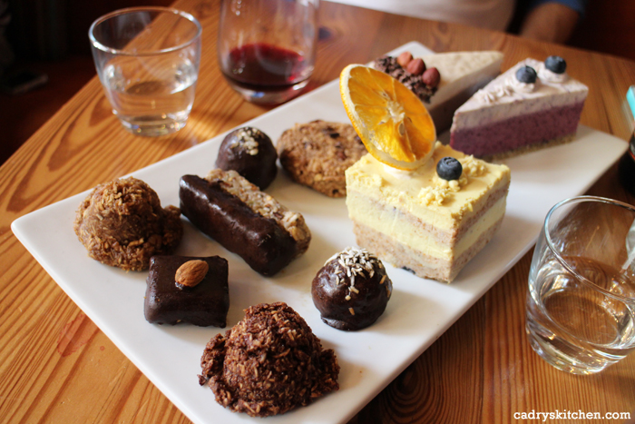 Dessert tray with cakes and chocolate covered bites.