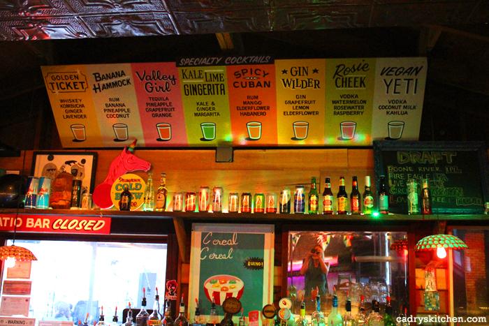 Tiki bar and menu at Cheer Up Charlie's.