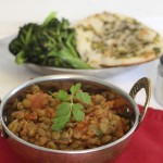 Masala lentils in kadhai on table.