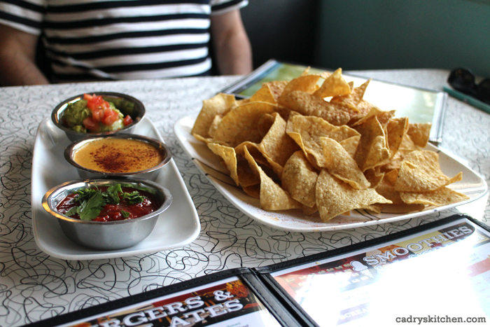 Salsa, vegan queso, and chips at Spiral Diner in Dallas, Texas