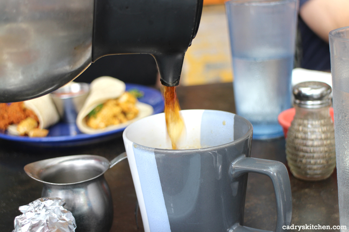 Coffee pouring into cup at Bouldin Creek Cafe.