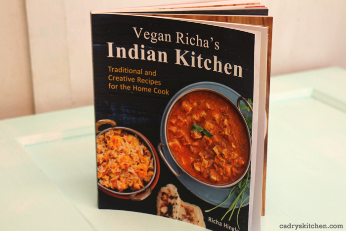 Vegan Richa's Indian Kitchen cookbook on table.