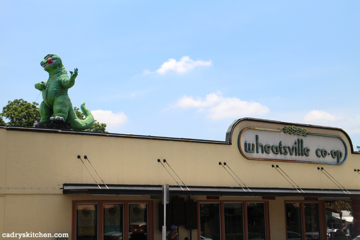 Exterior Wheatsville Co-op with Godzilla on roof.