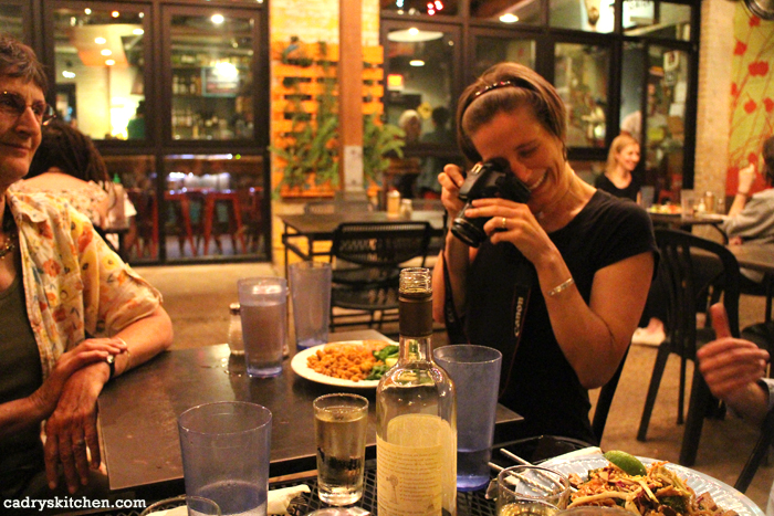Amey Mathews taking picture of her dinner at Bouldin Creek Cafe.