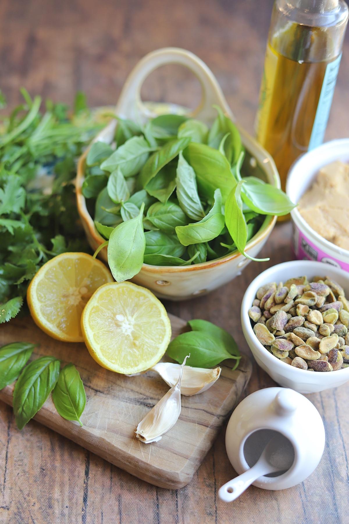 Ingredients for pistachio pesto on table.