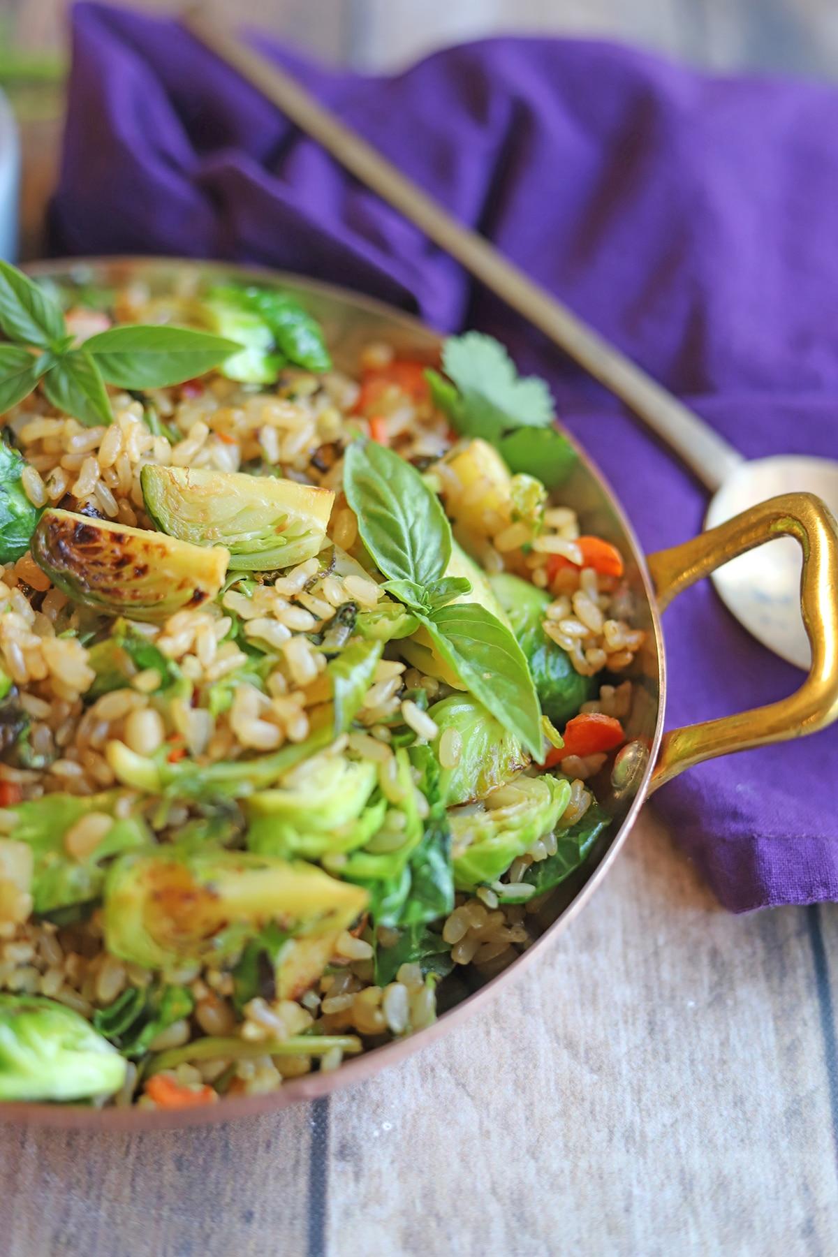 Fresh basil in vegan fried rice.