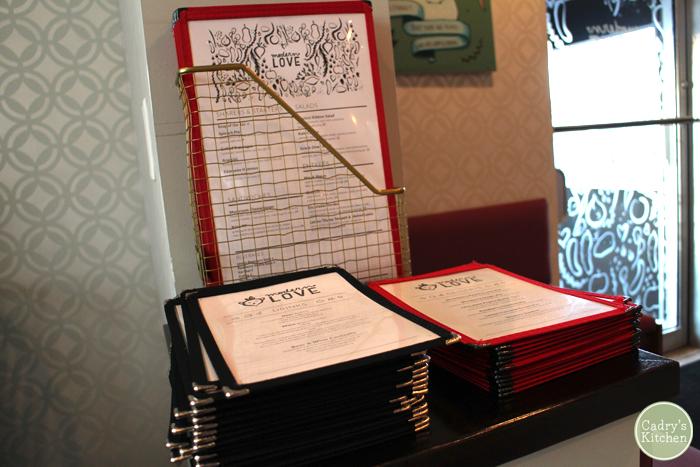 Stack of menus at Modern Love.