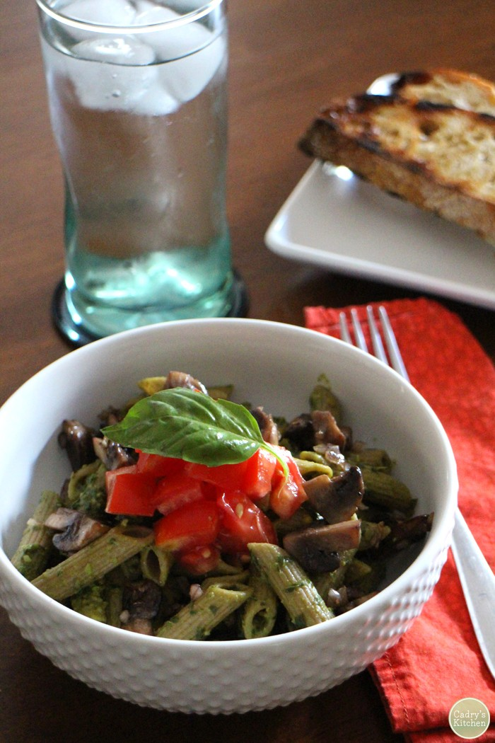 Cilantro basil pesto tossed with noodles and topped with tomatoes.