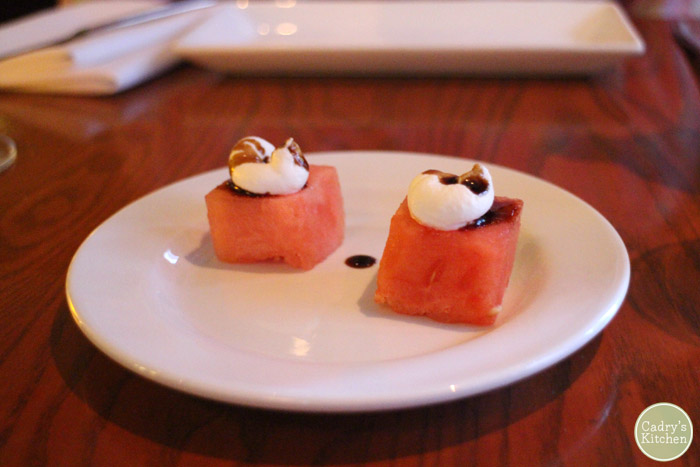 Squares of watermelon with drops of almond cheese & a balsamic reduction.