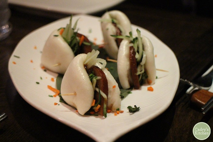 Steamed buns on plate.