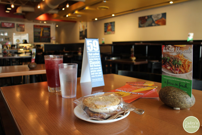 Interior Native Foods in Chicago, Illinois and oatmeal creme pie on table.
