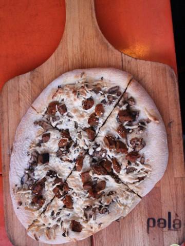 Pizza on wooden peel.