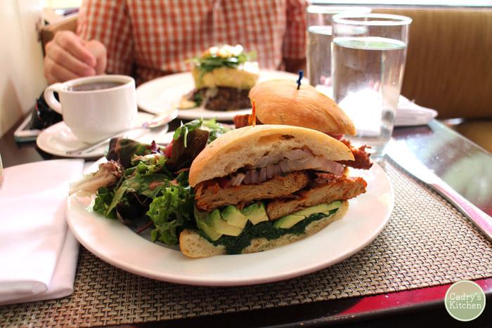 Cajun seitan sandwich on plate with salad.