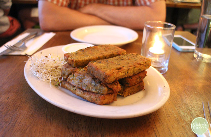 Stack of chickpea fries on plate.