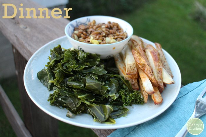 Text overlay: Dinner. Plate with lentils, collard greens, and fries.