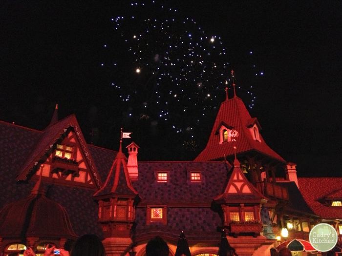 Fireworks in sky over Fantasyland.