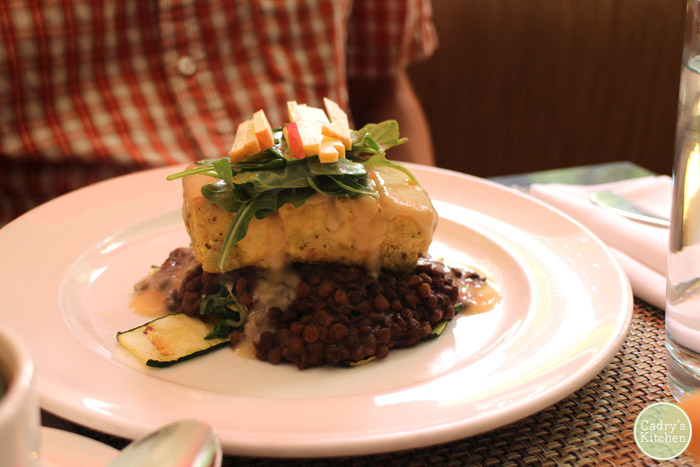 Breaded tofu with lentils on plate.
