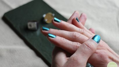 Hands with blue nail polish.