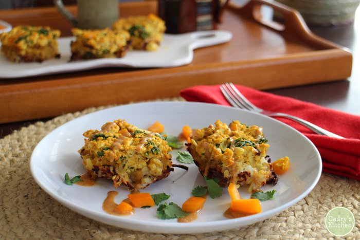 Breakfast nests with hash browns, tofu scramble, and cashew queso on a plate.