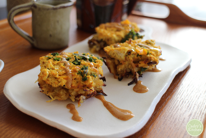 Breakfast nests with a creamy vegan queso - Made with hash browns & a tofu scramble. Great brunch idea! | cadryskitchen.com #vegan #brunch