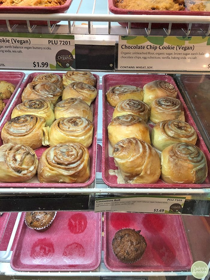 Bakery case with vegan cinnamon rolls at New Pioneer Co-op in Iowa City & Coralville.