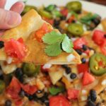Fried vegan nachos with spicy black beans