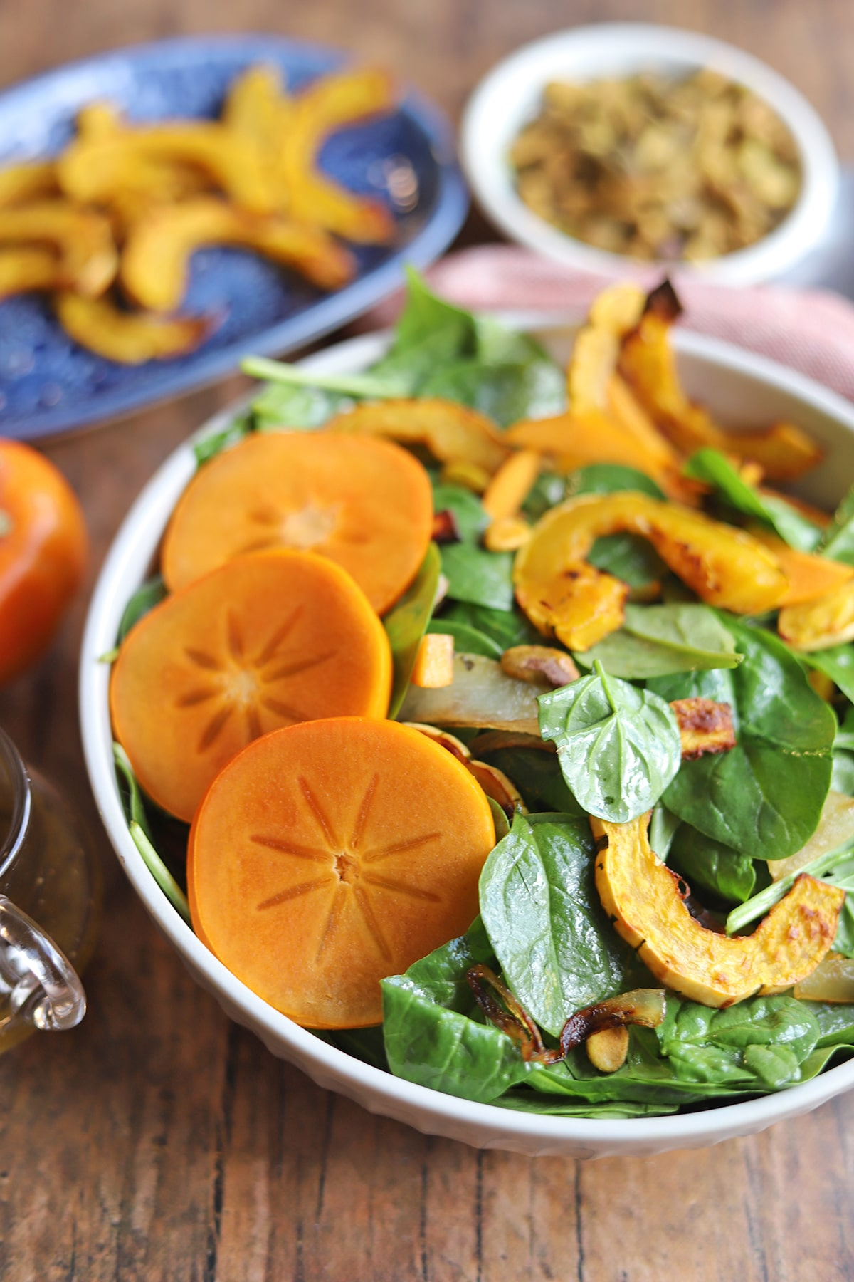 Persimmons on top of salad.