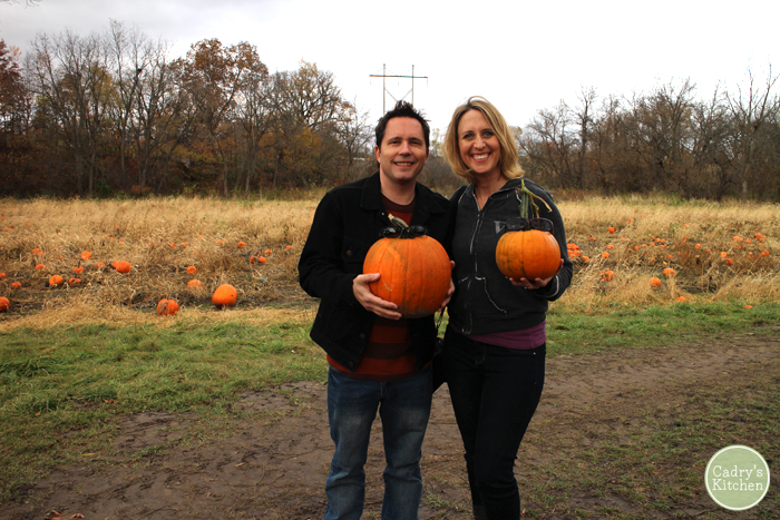 Cadry and David holding their pumpkins.