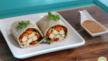 Spring roll-inspired vegan wraps with tofu, carrots, bell peppers, and peanut sauce.