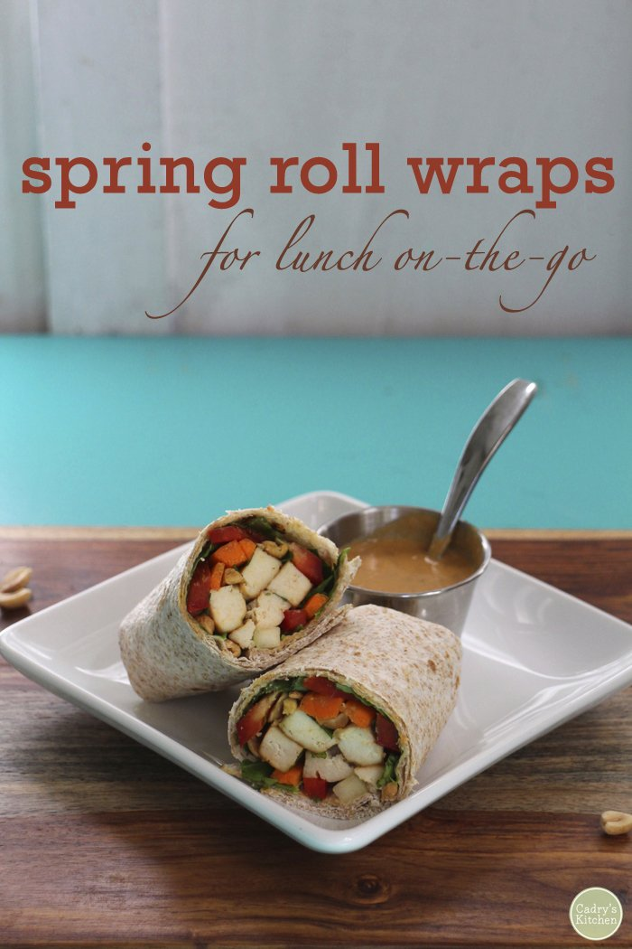 Text overlay: Spring roll wraps for lunch on-the-go. Vegan wraps on table with peanut sauce.