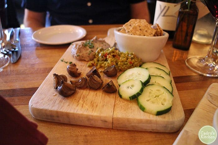 Vegan board at Brix in Iowa City with lentil pate, onions, cucumber, and olive tapenade.