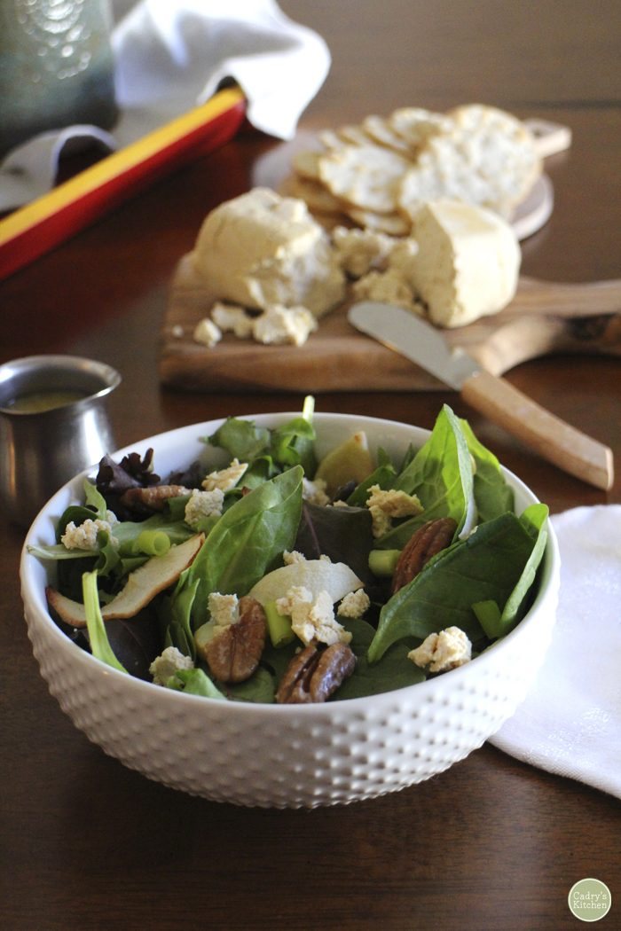 Roasted apple salad in bowl with tofu chevre.