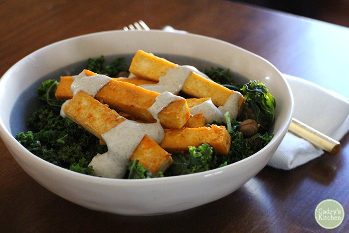 Buffalo tofu over greens with ranch dressing.