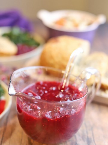 Cranberry sauce in glass serving bowl.