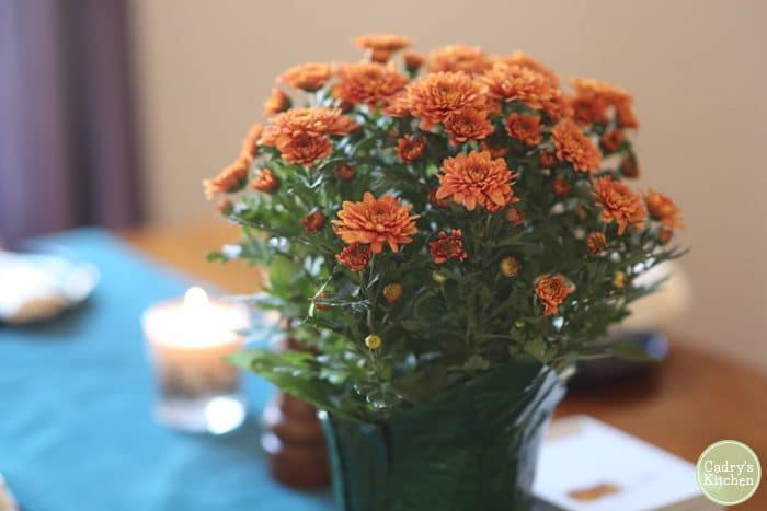 Flowers on table at vegan Thanksgiving. Vegan Thanksgiving recipes.