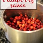 Text: Orange cranberry sauce. Vegan and gluten-free. Whole cranberries in pot.