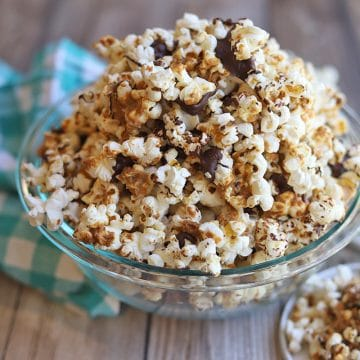 Peanut butter chocolate popcorn in clear bowl.