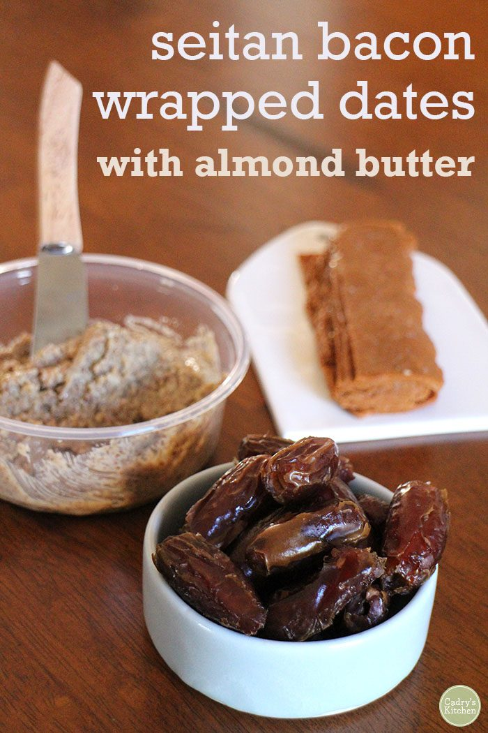 Text overlay: Seitan bacon wrapped dates with almond butter. Dates in bowl by almond butter container and stack of seitan bacon.