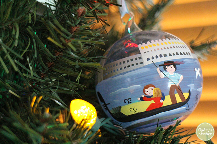 Glass hand painted Christmas bulb on tree with couple on boat in Venice.
