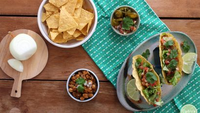 These chickpea tacos are a delicious weeknight meal. With the spices of ancho chili powder, cumin & paprika, they are mouthwateringly good. Just add toppings for a complete meal! Plus a cooking video to see how they are made. | cadryskitchen.com #vegan #glutenfree