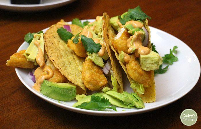 Vegan fish tacos with avocado and cilantro.