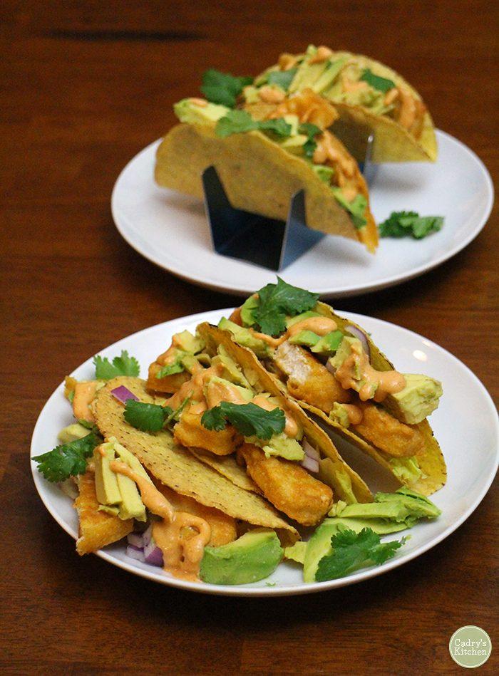 Vegan fish tacos on plates.