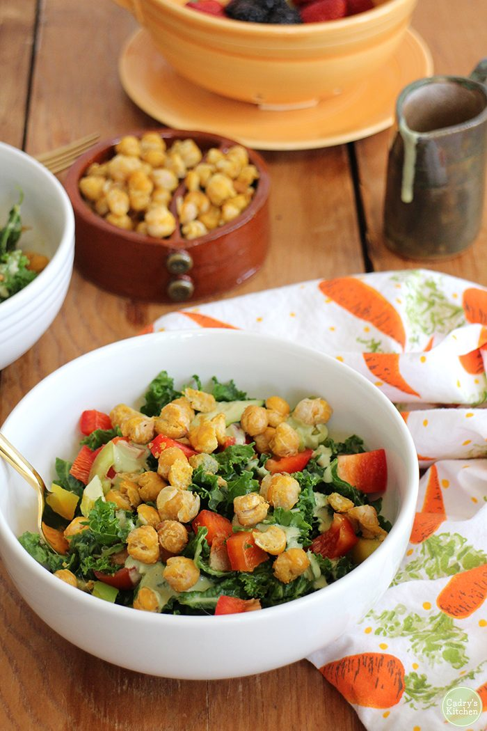 Kale salad with roasted chickpeas in bowl.