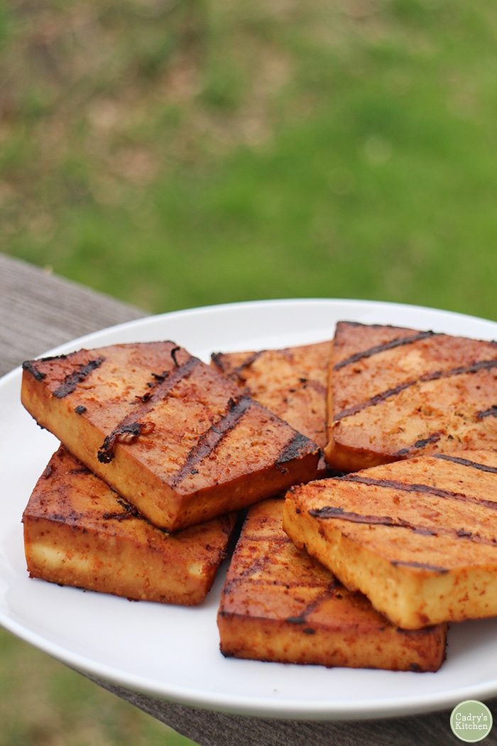 Grilled slabs of bulgogi tofu on plate.